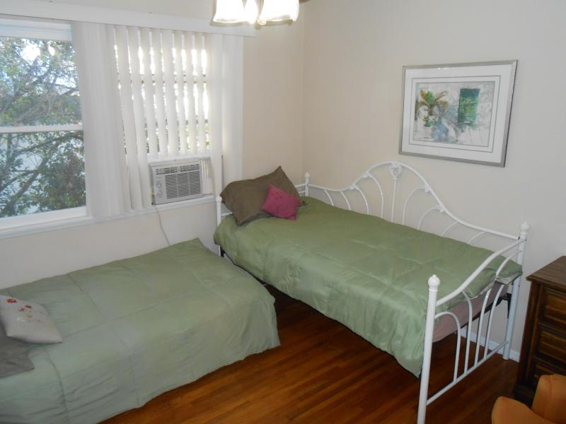 Second Bedroom with two twin beds, one has memory foam