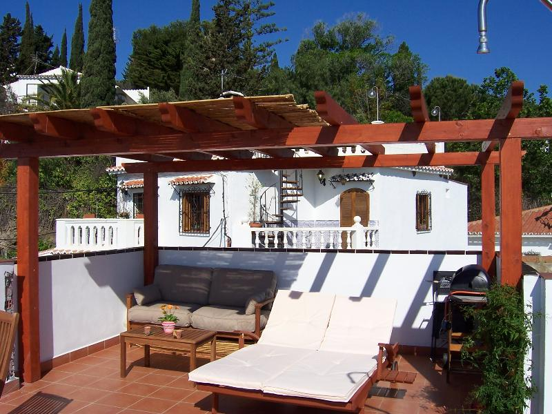 Sun lounges on roof terrace