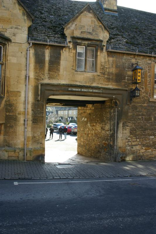 view from high street through the old archway to Matilda Cottage.