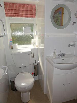 Your fresh and simple bathroom with sparkling white sanitary equipment