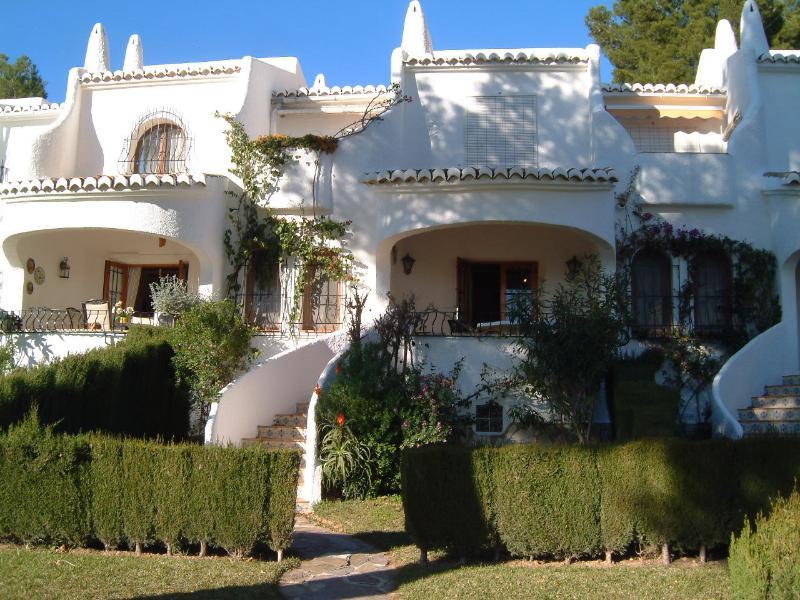 The rear terrace and garden of Casa Evangelina