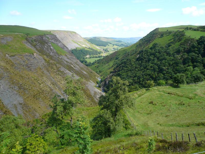 The cottage is located at the base of this scenic valley as  viewed from the road near Dylife.