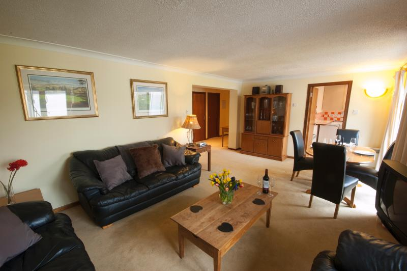 Spacious open plan living dining with double doors onto balcony