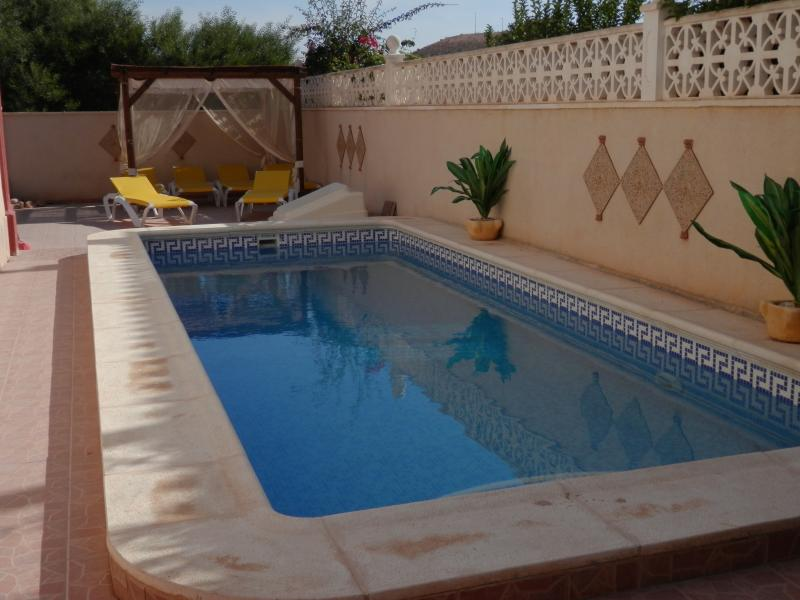 6 Sunloungers & shaded area by pool