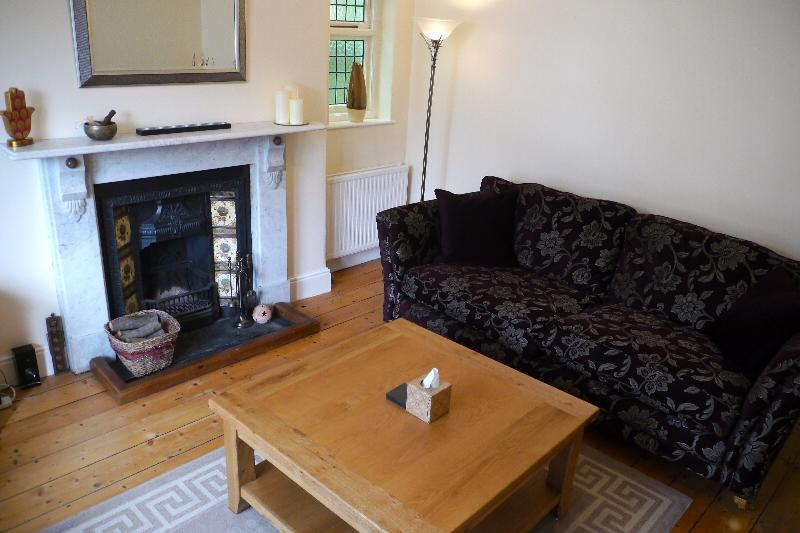 Spacious Lounge with original feature fire place & luxury sofas