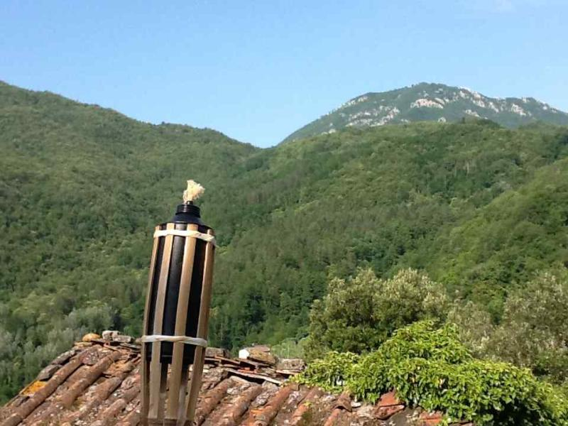 Torches on the roofs of Cocciglia and view of the Apennines