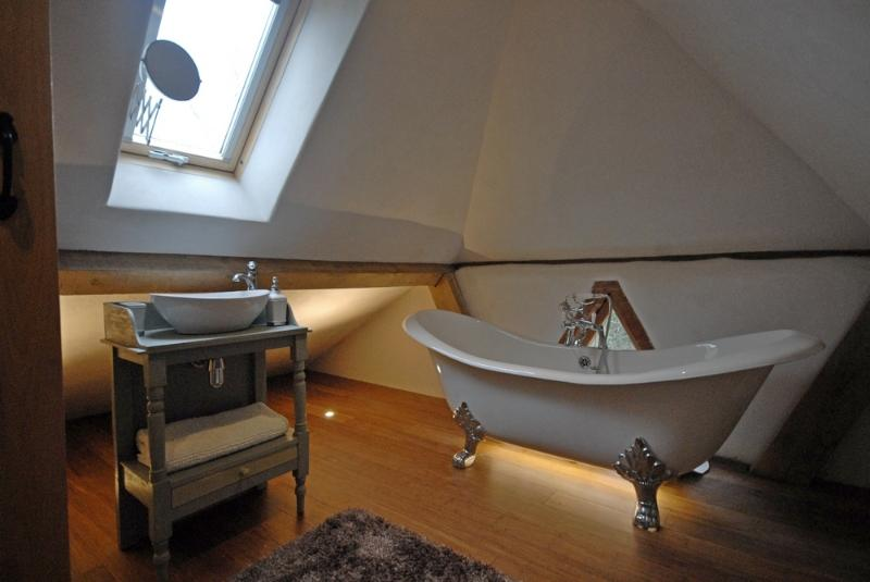 Luxurious upstairs bathroom with double ended slipper bath