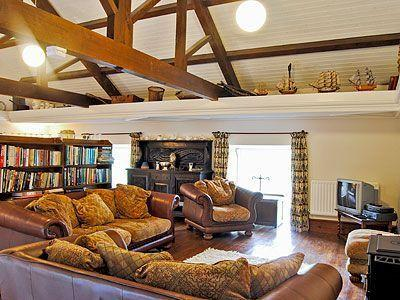 Upstairs lounge with views ans exposed beams