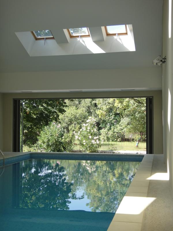 The heated pool with doors open