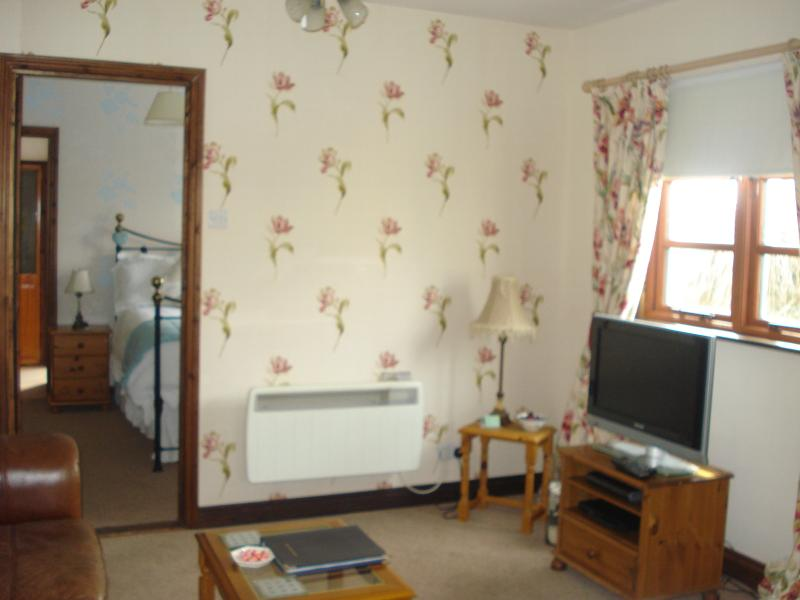 Lounge with a 32 in Flat screen tv with Sky