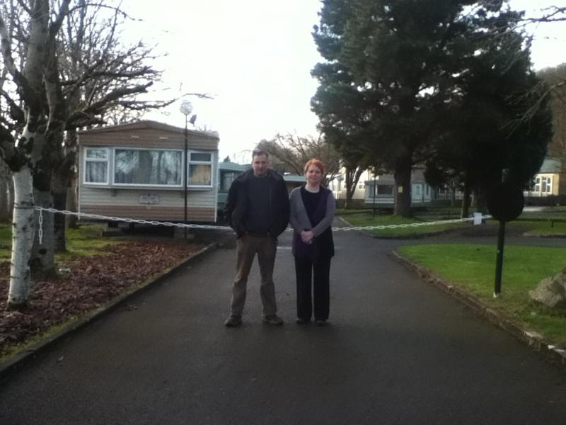 JOAN & TONY IN FRONT OF THE LARGE 3 BED MOBILE HOME.