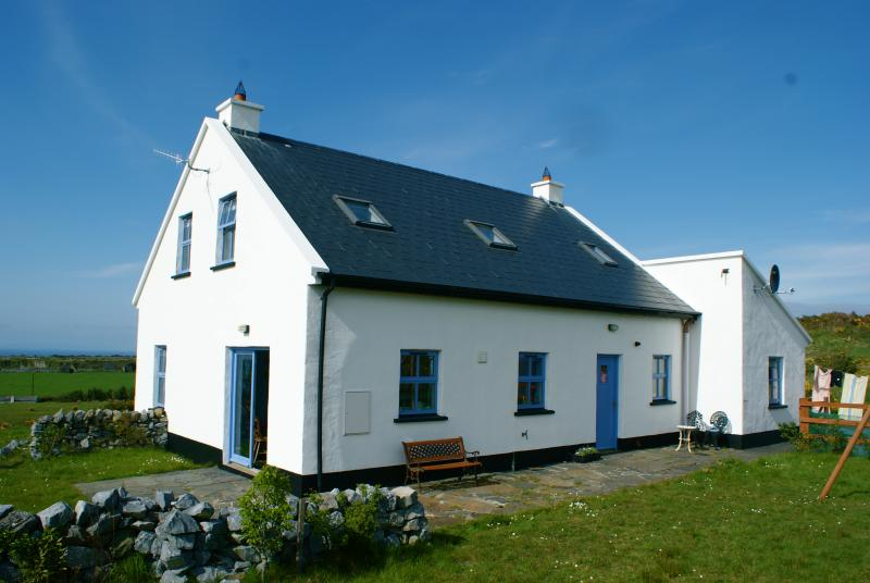 The back of the house from the south side - with the sea of Galway Bay in the distance