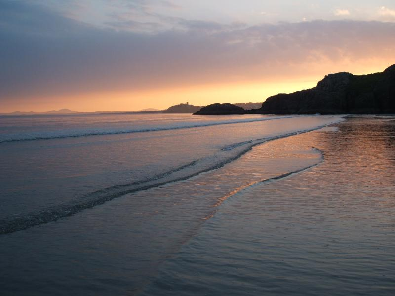 Sunset over Criccieth with the castle on its headland