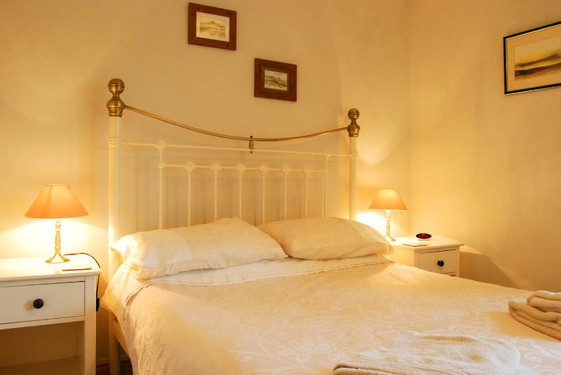 Comfortable double bed with king size quilt so you can cosy up and admire the views