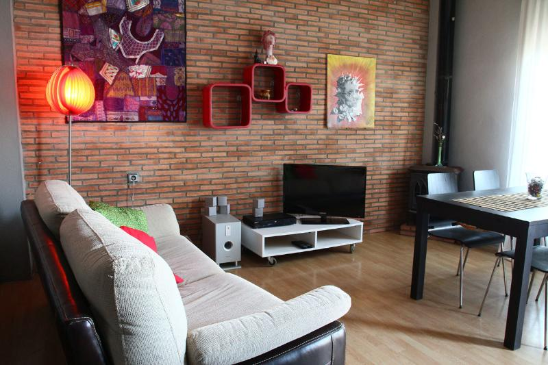Hall, now the distribution is changed, the furniture is the same except the TV table that is black.