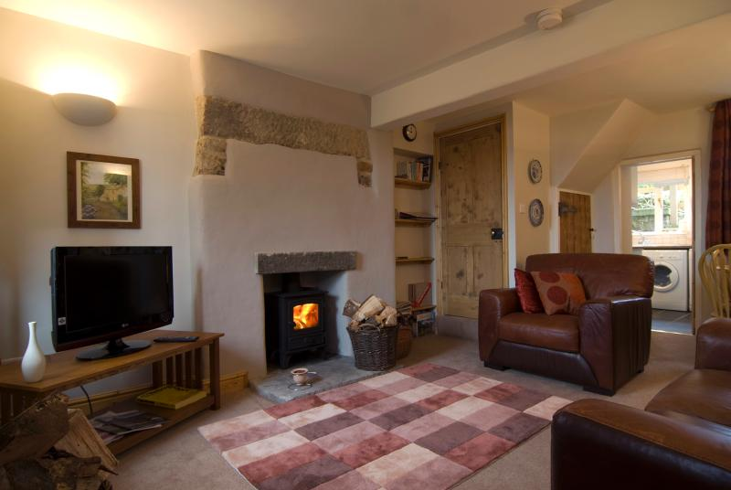 Comfortable lounge with log burning stove, local guides, books, games, music and films