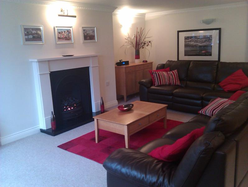 Living room with sumptuous leather sofas, wide screen TV with Virgin Media TiVo and free WiFi