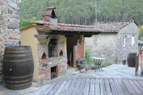 The Tuscan wood-fired pizza oven on the patio