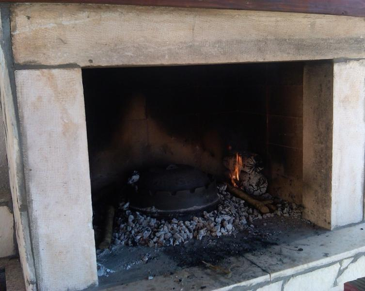 Making traditional Istrian 'peka'