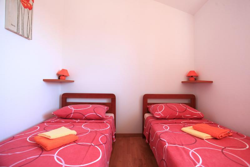 Bedroom with twin beds which can be arranged as a double if you prefer; each guest gets two towels