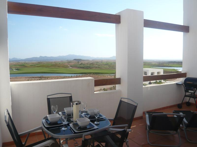 Balcony looking out to golf course and mountains