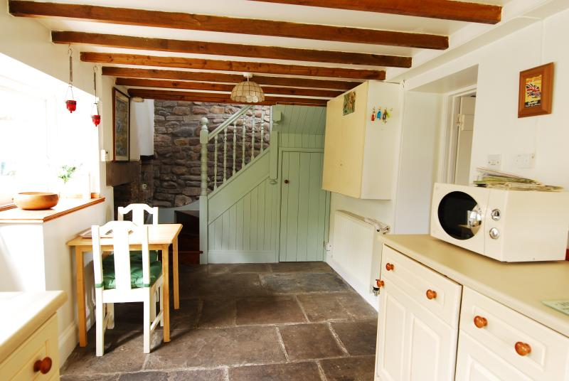 The kitchen and stairs