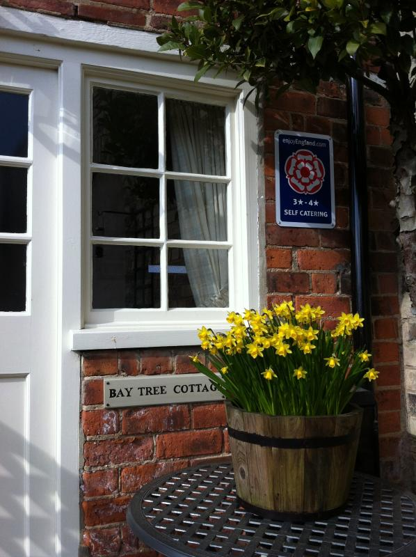 Spring at Nordham Cottages S facing courtyard with bluebells/daffodils. In 2014 we were raised to 4*
