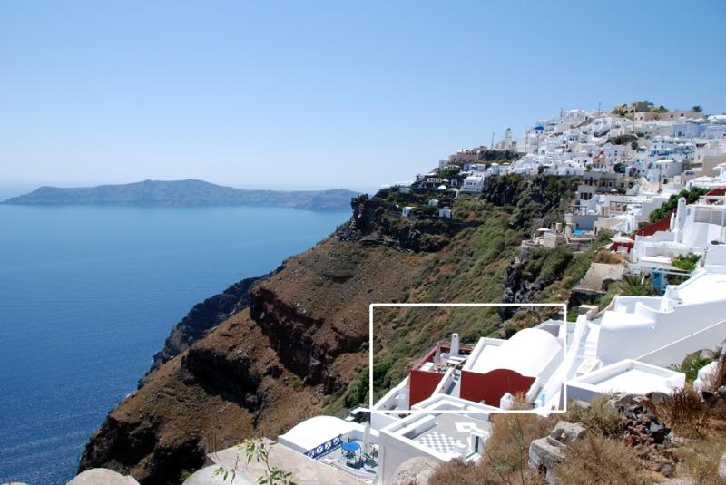 Typical Santorini architecture at the very edge of the rim of the Caldera