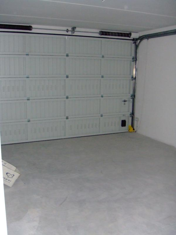 Garage with automatic door opener and motion-sensing light
