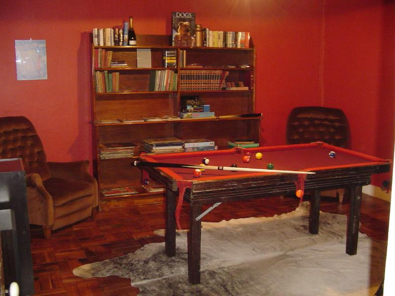 Games room with pool table, books, record player