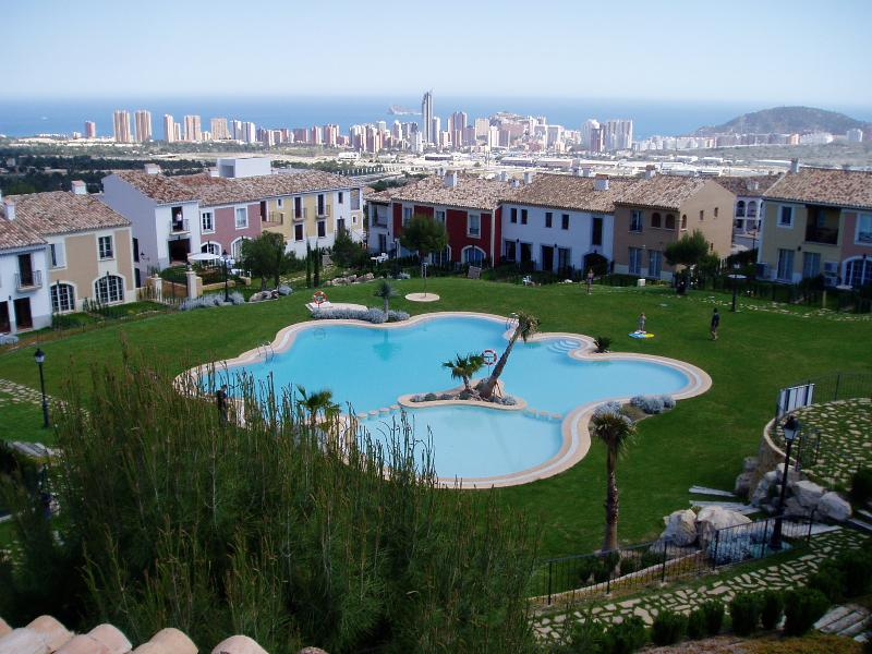 View of house, communal pool and Benidorm/La Cala