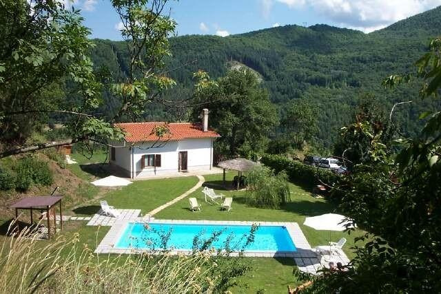 House with beautiful mountain views and large flat well equipped garden. Pure peace!