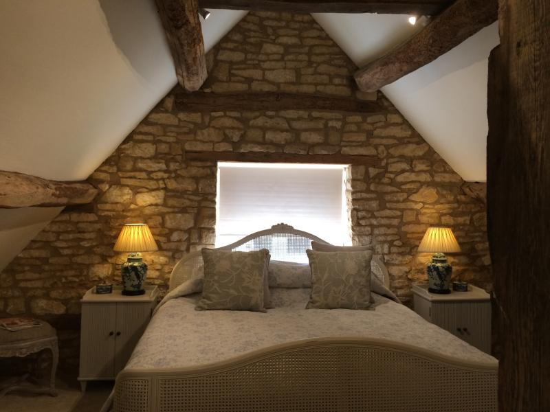 Bedroom with exposed beams - light and fresh with superb quality linen and Super King size bed.