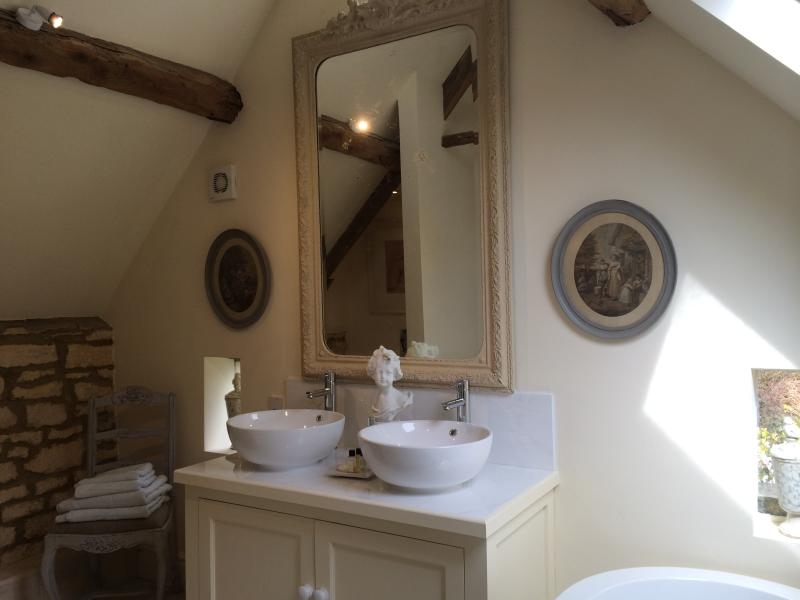 Both bathrooms are en-suite and have double basins and baths - plus one has a large walk in shower.