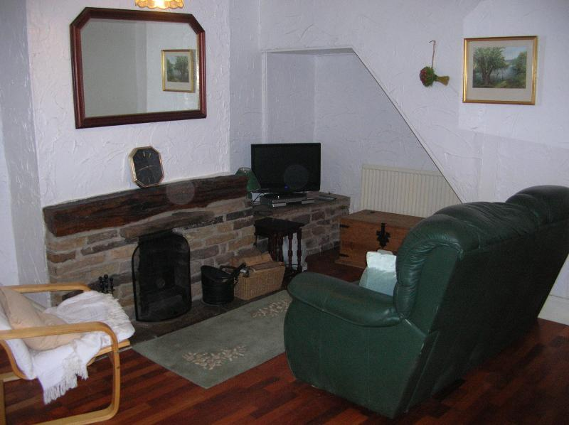 Living Room with wood burner and wide selection of DVDs, books and games.
