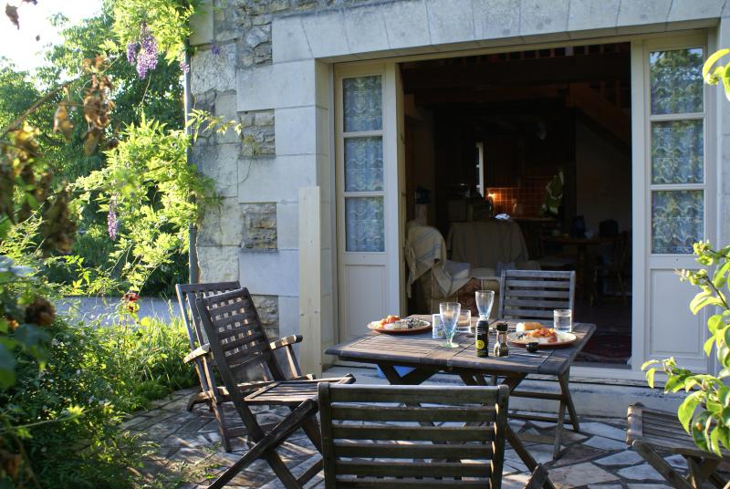 Private patio / sitting out area in full sunshine. French windows to the living room.  BBQ supplied