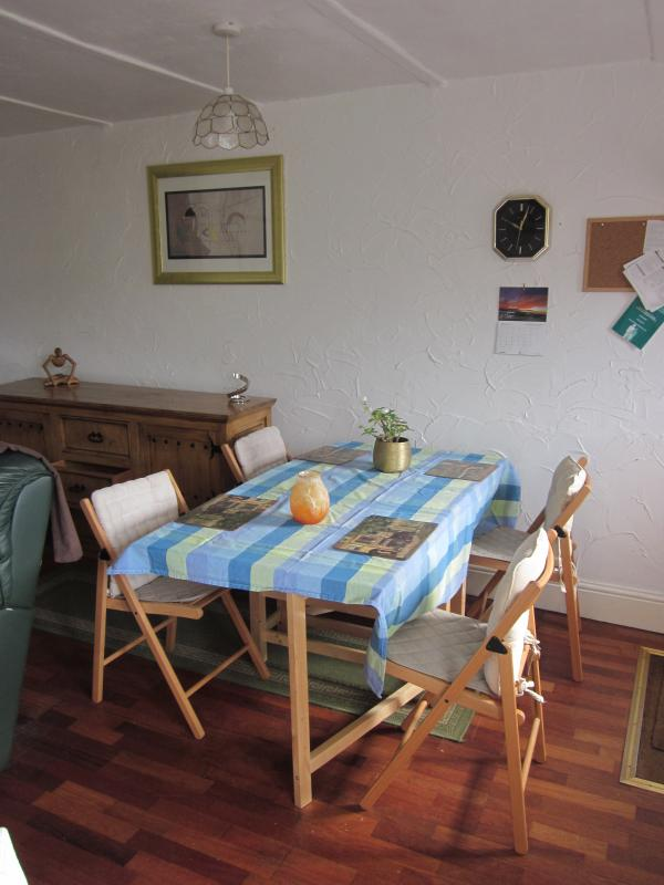 The dining area in the living room- high chair also available.