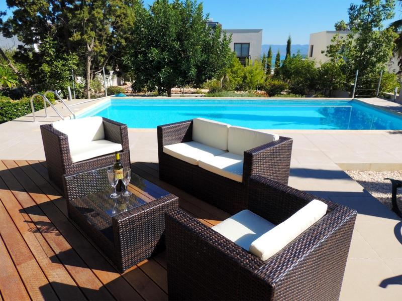 Decked Patio Area - perfect for chilling out by the pool with a glass of wine.