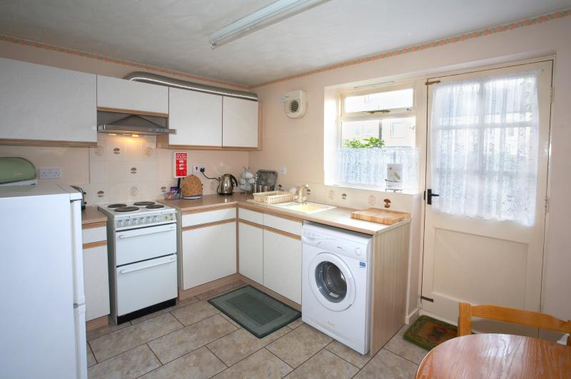 A well equipped kitchen with modern appliances.