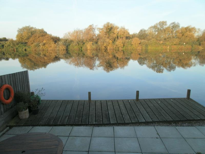 A beautiful autumnal day.  What a calm river and wonderful reflection.