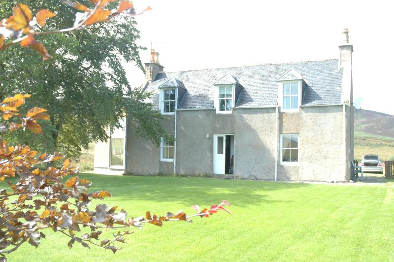A Traditional Scottish Farmhouse with front lawn