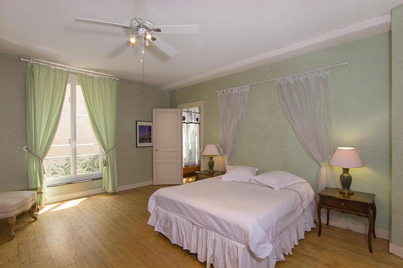 Largest green bedroom also has a garden view, reading chair, and fireplace. It sleeps three.