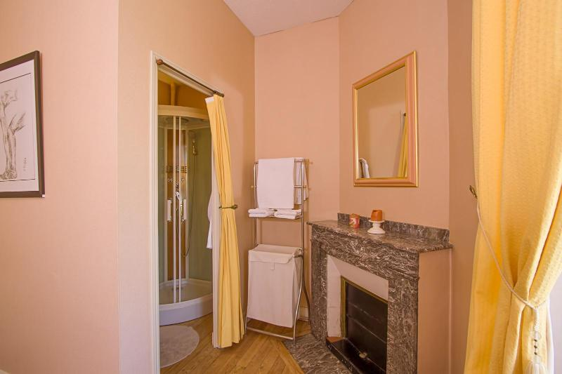 Pink bedroom also has a fireplace and a small private bathroom.