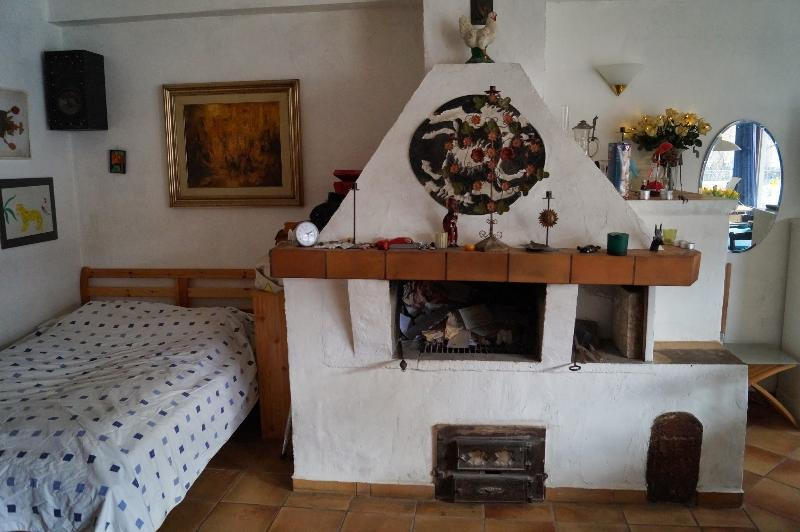 Living room with chimney and extra bed