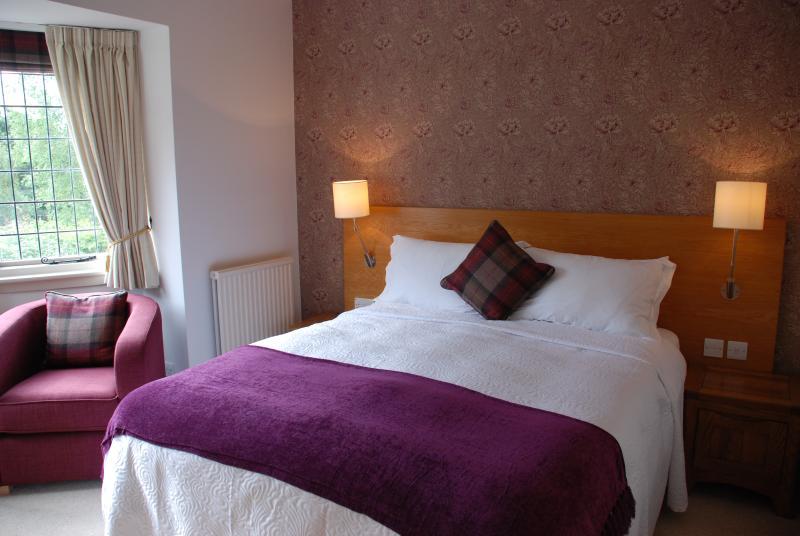 Ensuite bedroom in Baillie Scott Cottage