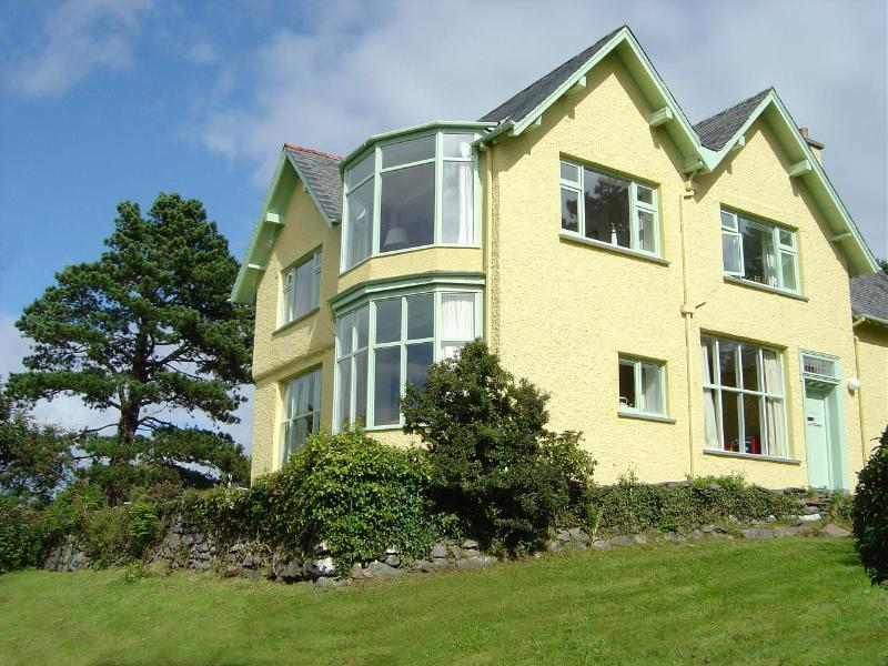 The house, showing the huge bay windows that give you the view :-)
