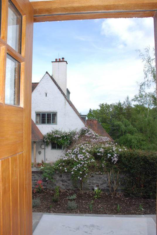 Looking out the front door of Baillie Scott Cottage