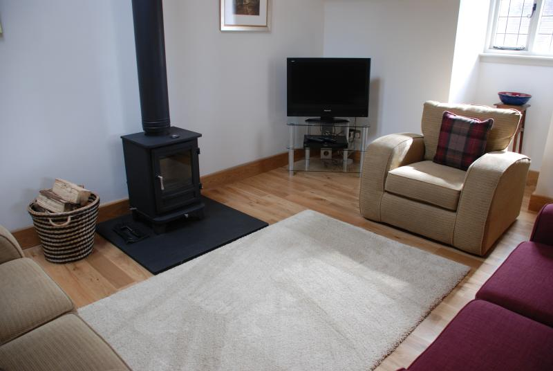 Sitting area with wood burning stove - very cosy in the winter