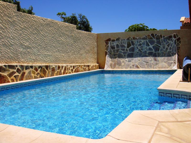 Private heated pool that is gated for the security of unsupervised children.