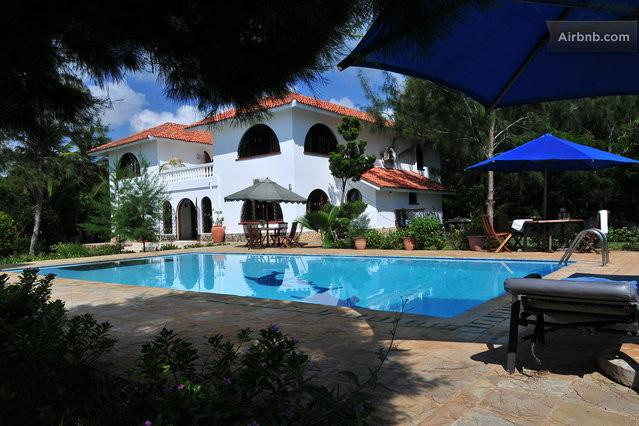 the tranquil villa and sorrounding seen from the poolside.